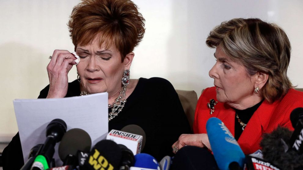 Beverly Young Nelson, left, the latest accuser of Alabama Republican Roy Moore, reads her statement as attorney Gloria Allred looks on, at a news conference, in New York, Nov. 13, 2017.