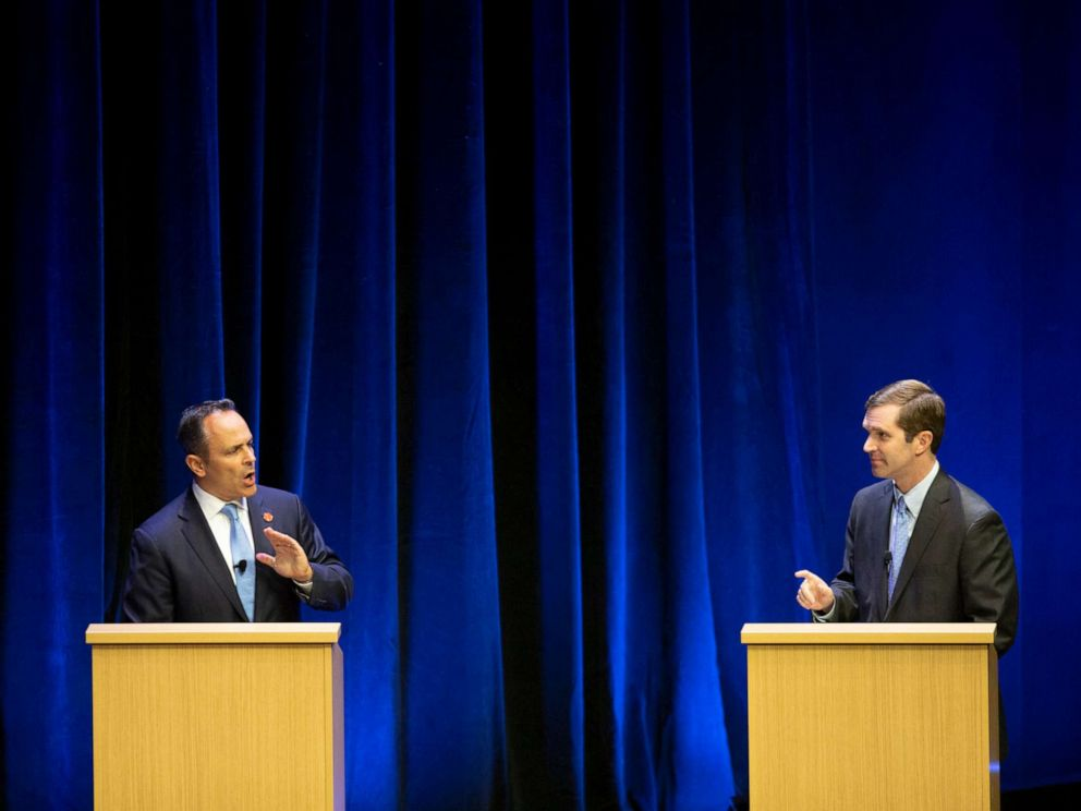 PHOTO: Republican Gov. Matt Bevin, left, and Democratic Attorney General Andy Beshear participate in a debate at the Singletary Center for the Arts on the University of Kentucky campus in Lexington, Ky.