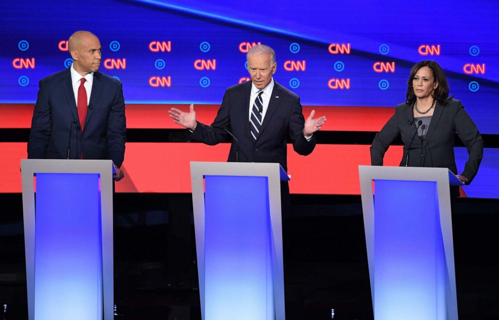 PHOTO: Democratic presidential hopefuls US Senator from New Jersey Cory Booker (L), former Vice President Joe Biden (C) and US Senator from California Kamala Harris (R) speak during the second round of the second Democratic primary debate.