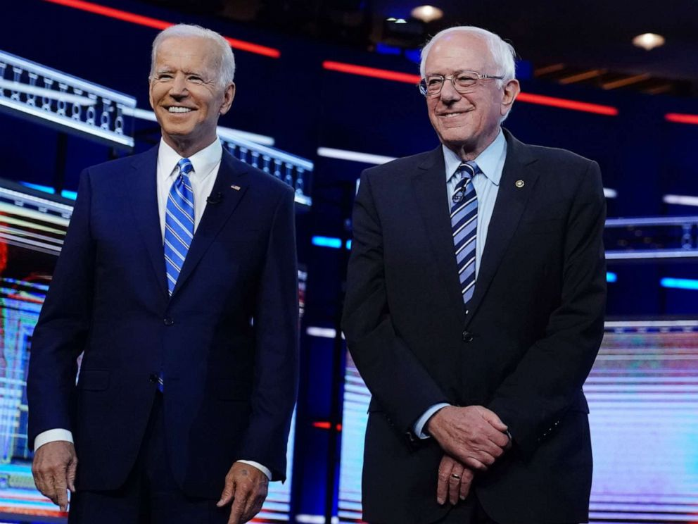 PHOTO: Democratic 2020 election presidential candidates former Vice President Joe Biden and Senator Bernie Sanders pose before the start of the debate in Miami, June 27, 2019.