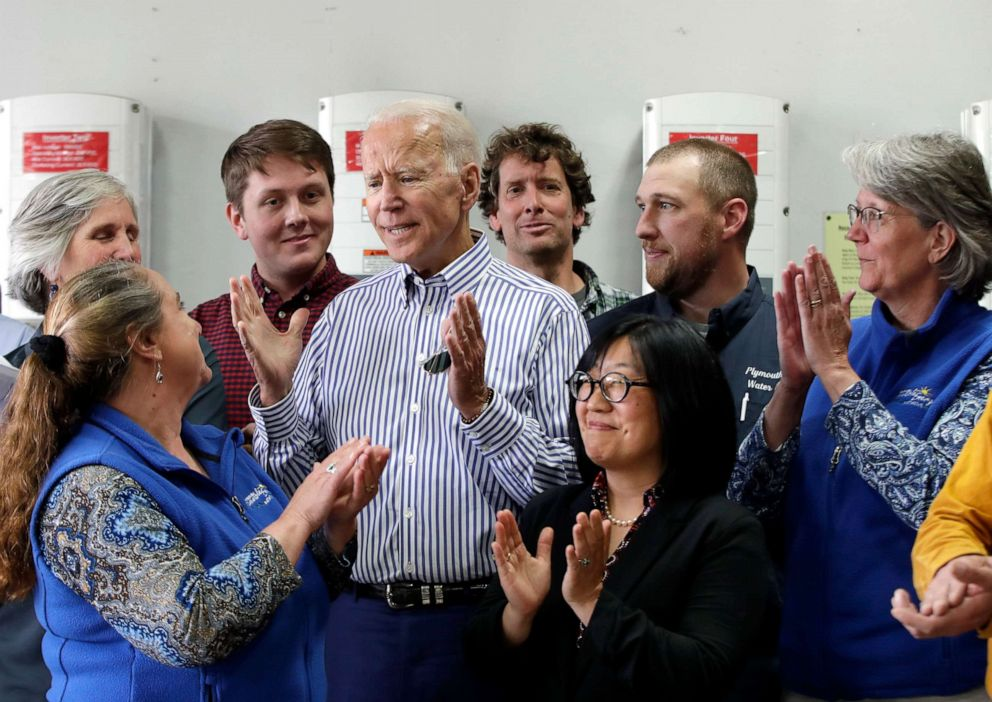 PHOTO: Joe Biden, center, is applauded as he speaks during a tour at the Plymouth Area Renewable Energy Initiative on June 4, 2019, in Plymouth, N.H.