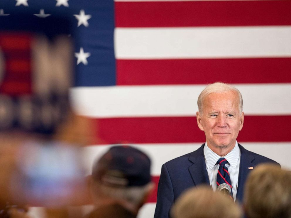 PHOTO: Democratic presidential candidate, former Vice President Joe Biden stands on stage while the crowd applauds during a campaign event on Oct. 9, 2019 in Manchester, N.H.
