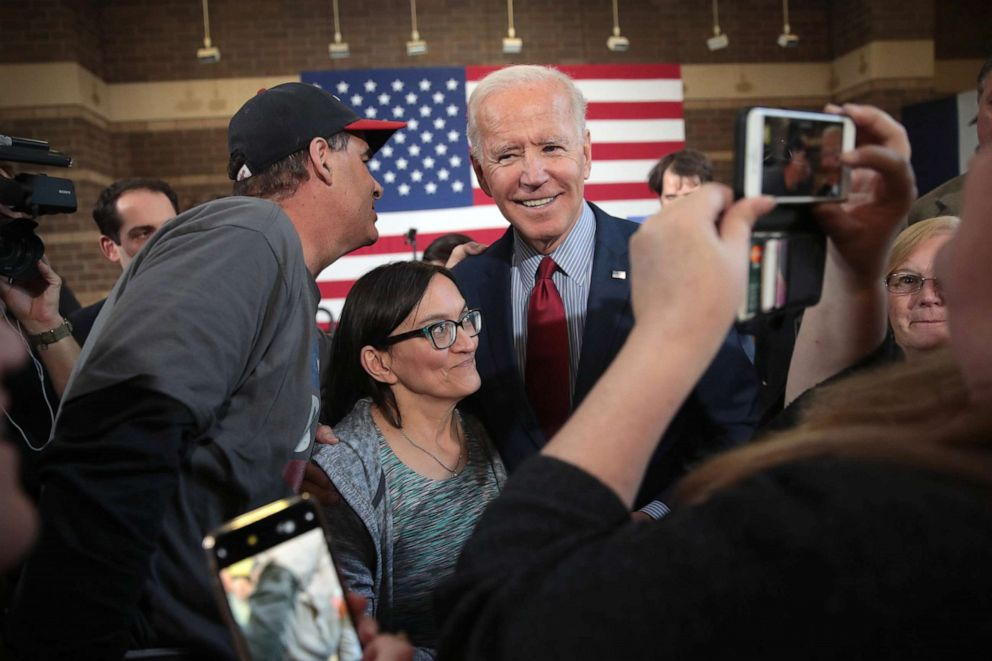 PHOTO: Democratic presidential candidate former vice president Joe Biden greets guests during a campaign stop, Oct. 16, 2019, in Davenport, Iowa.