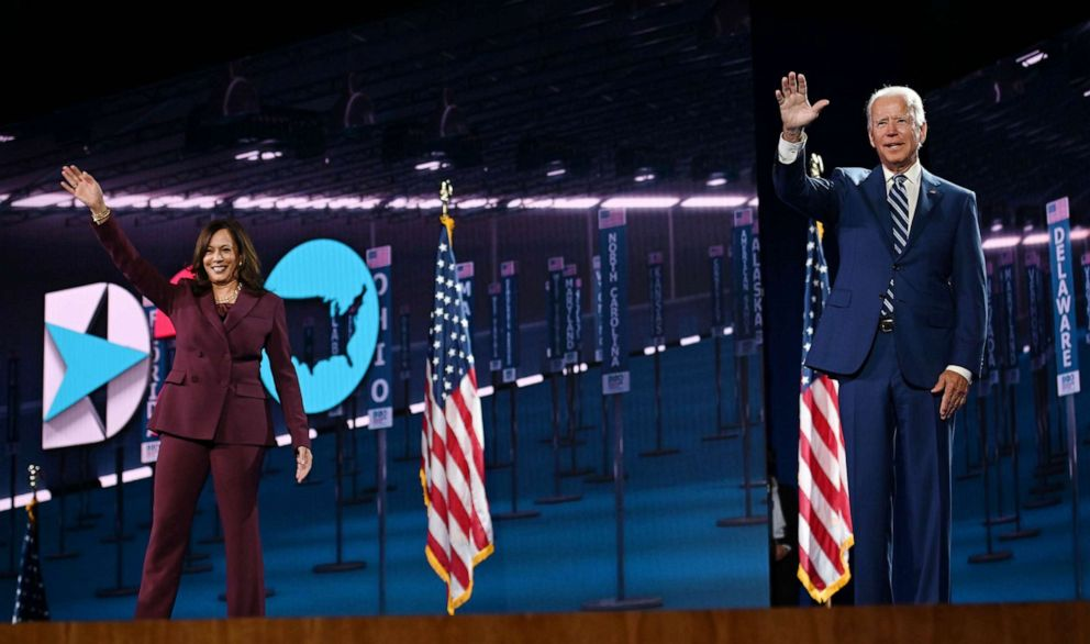 PHOTO: Sen. Kamala Harris and former Vice President Joe Biden wave from the stage at the end of the third day of the Democratic National Convention, in Wilmington, Del., Aug. 19, 2020.