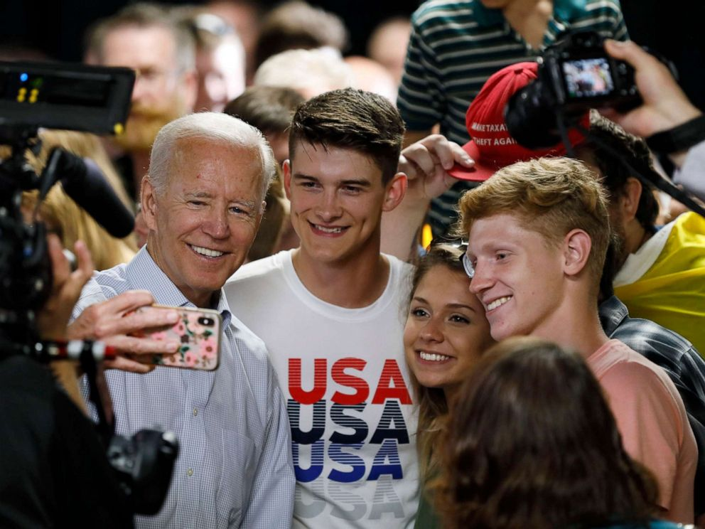 PHOTO: Democratic presidential candidate and former Vice President Joe Biden poses for a photo with audience members during a community event, July 17, 2019, in Council Bluffs, Iowa.