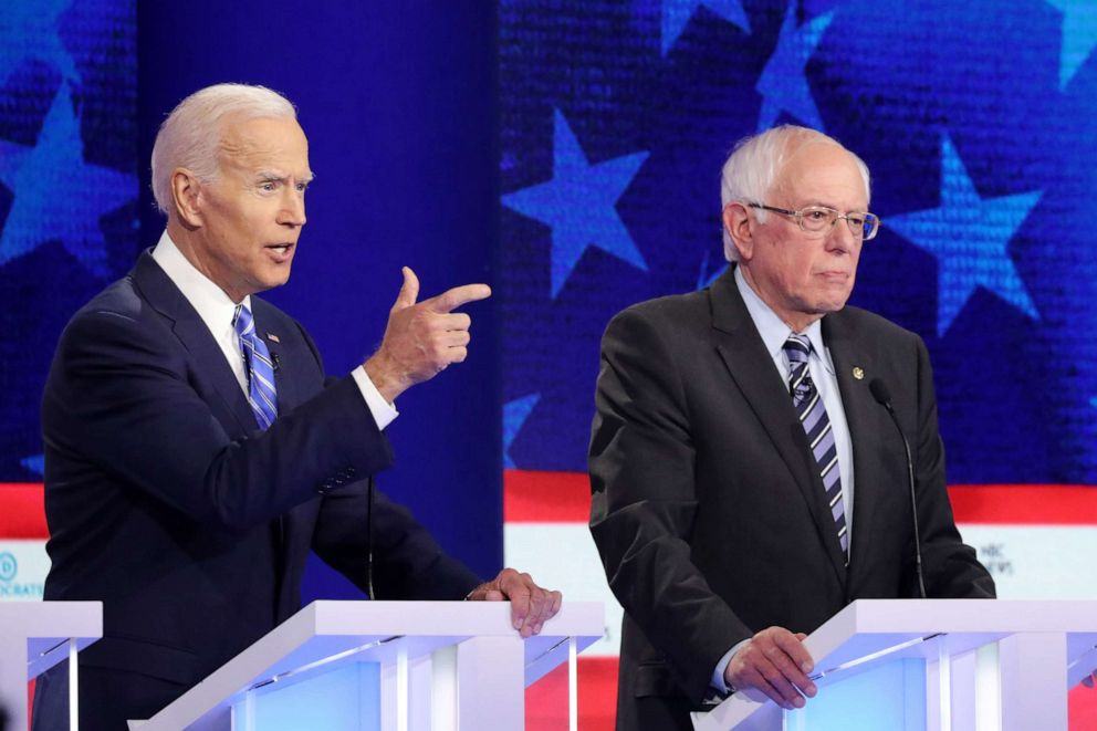 PHOTO: Joe Biden and Bernie Sanders participate in the second night of the first 2020 democratic presidential debate at the Adrienne Arsht Center for the Performing Arts in Miami, June 27, 2019.