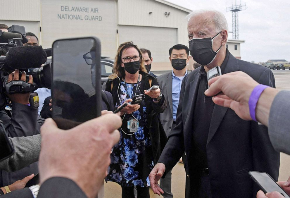 PHOTO: President Joe Biden speaks to the press before boarding Air Force One at New Castle airport in New Castle, Del., March 28, 2021.