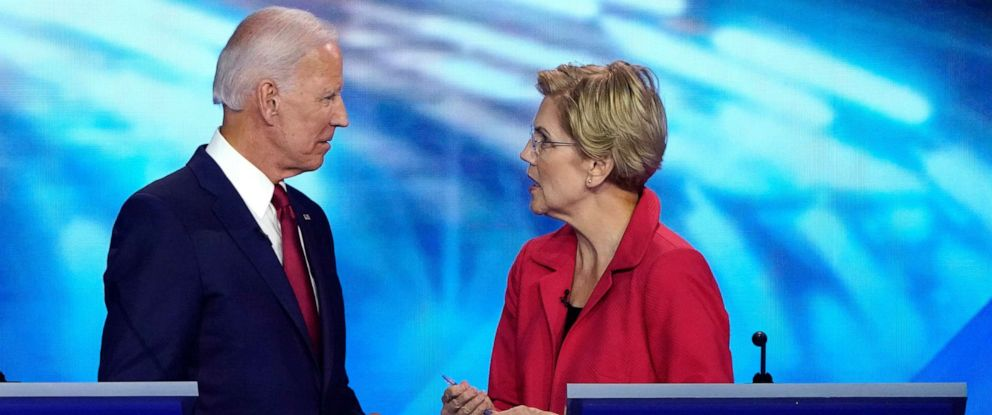 PHOTO: Former Vice President Joe Biden speaks with Senator Elizabeth Warren during the 2020 Democratic U.S. presidential debate in Houston, Texas, Sept. 12, 2019.