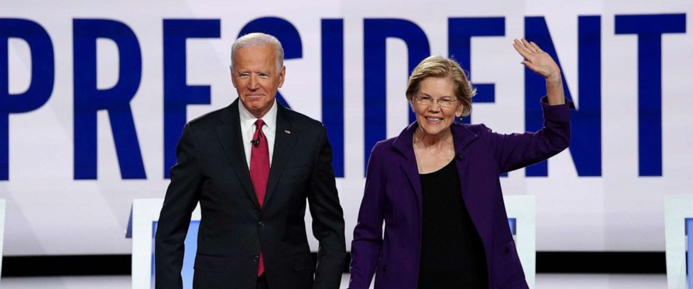 PHOTO: Democratic presidential candidates former Vice President Joe Biden and Senator Elizabeth Warren pose together at the start of the fourth Democratic presidential candidates 2020 election debate in Westerville, Ohio, Oct. 15, 2019.