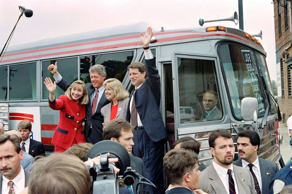 PHOTO: Democratic Presidential candidate Bill Clinton and running mate Al Gore wave to supporters before boarding their bus in Columbus, Georgia, Sept. 23, 1992.