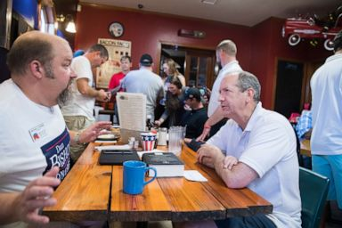 PHOTO: Dan Bishop, right, Republican candidate for North Carolinas 9th District, talks with supporters at Robins On Main diner in Hope Mills, N.C., on Saturday, August 10, 2019.