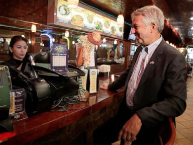 PHOTO: Bob Hugin, right, the Republican candidate in the U.S. Senate race in New Jersey, purchases a Mega Millions lottery ticket at Sabor Latino, a restaurant where he held a news conference Tuesday, Oct. 23, 2018, in Newark, N.J.