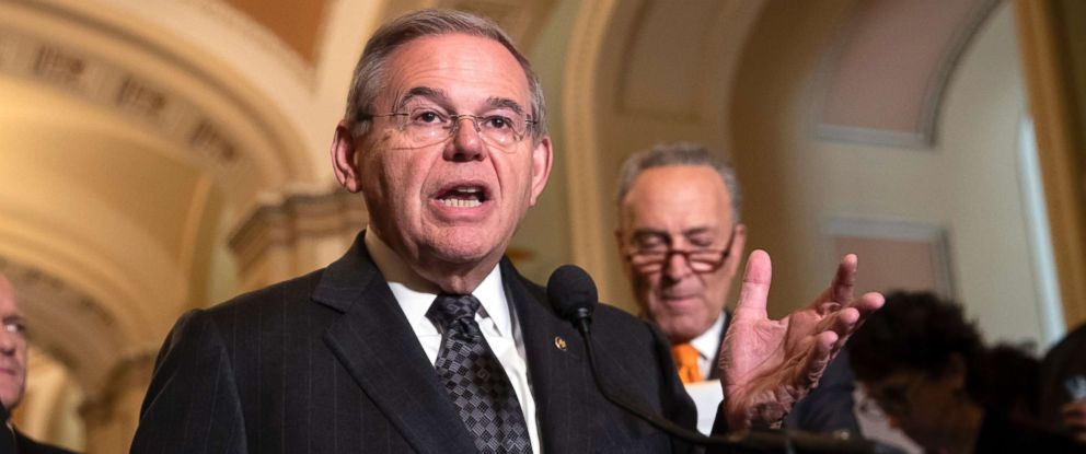 PHOTO: Sen. Bob Menendez the ranking member of the Senate Foreign Relations Committee, joined at right by Senate Minority Leader Chuck Schumer, talks to reporters on Capitol Hill in Washington, June 12, 2018.
