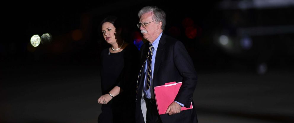 PHOTO: White House press secretary Sarah Huckabee Sanders and national security adviser John Bolton arrive at Andrews Air Force Base in Md., to greet three Americans detained in North Korea for more than a year, May 10, 2018.