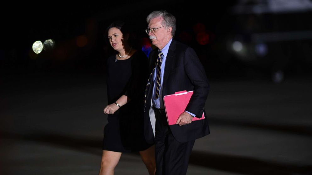 White House press secretary Sarah Huckabee Sanders and national security adviser John Bolton arrive at Andrews Air Force Base in Md., to greet three Americans detained in North Korea for more than a year, May 10, 2018.