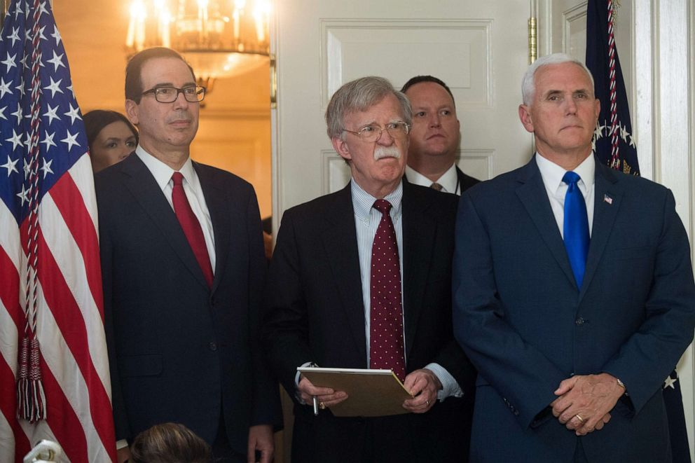 PHOTO: National Security Advisor John Bolton stands with Treasury Secretary Steven Mnuchin and Vice President Mike Pence as they listen to President Donald Trump at the White House, May 8, 2018.