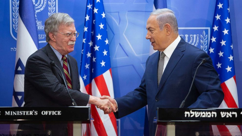 Israeli Prime Minister Benjamin Netanyahu, right, shakes hands with U.S. national security adviser John Bolton during their meeting at the Prime Minister's office in Jerusalem, Aug. 20, 2018.