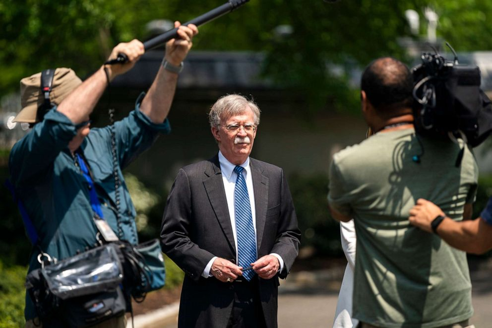 driving  street PHOTO: National Security Advisor John Bolton speaks to the media about the ongoing political turmoil in Venezuela outside the West Wing of the White House in Washington, May 3, 2019.