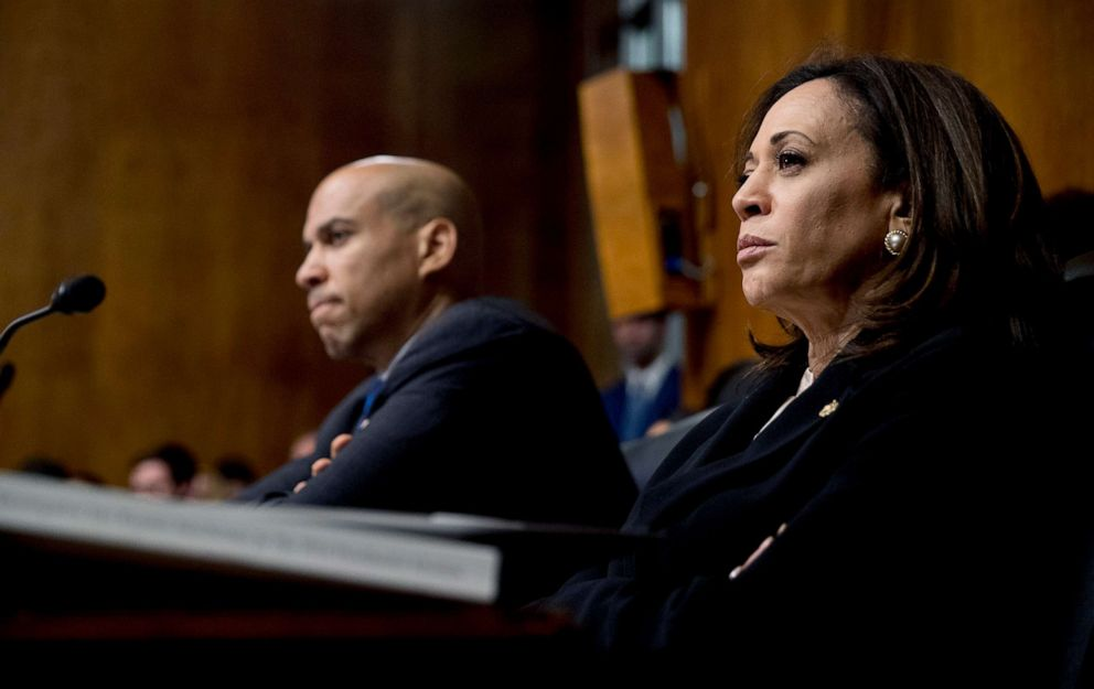 PHOTO: Democratic presidential candidates Sen. Cory Booker, left, and Sen. Kamala Harris, right, listen as Attorney General William Barr testifies during a Senate Judiciary Committee hearing on Capitol Hill in Washington, D.C., May 1, 2019.