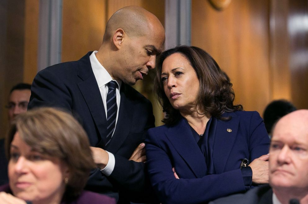 PHOTO: Dem. Senator from New Jersey Cory Booker speaks with Democratic Senator of California Kamala Harris as the Senate Judiciary Committee voted to advance Brett Kavanaughs Supreme Court nomination to the Senate floor in Washington, Sept. 28, 2018.