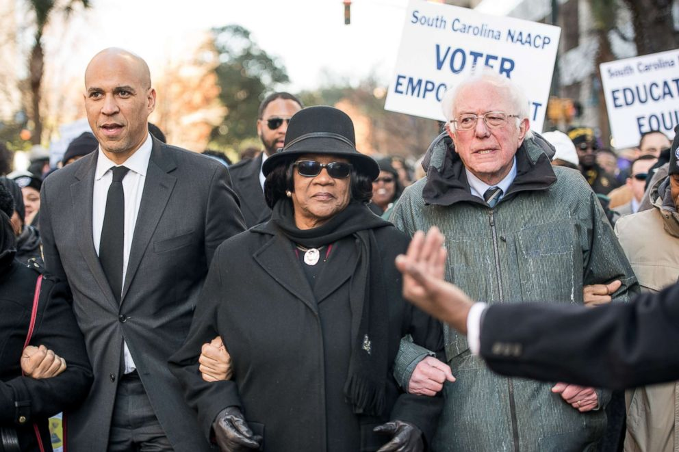 PHOTO: Sen. Bernie Sanders (I-VT), right, president of the South Carolina NAACP chapter, Brenda Murphy, center, and Sen. Cory Booker (D-NJ) march to the Statehouse in commemoration of Martin Luther King Jr. Day, Jan. 21, 2019, in Columbia, S.C.