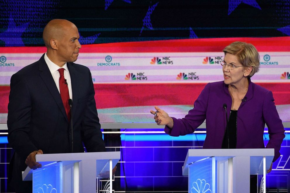 PHOTO: Cory Booker and Elizabeth Warren participate in the first Democratic primary debate hosted by NBC News at the Adrienne Arsht Center for the Performing Arts in Miami, Florida, June 26, 2019.