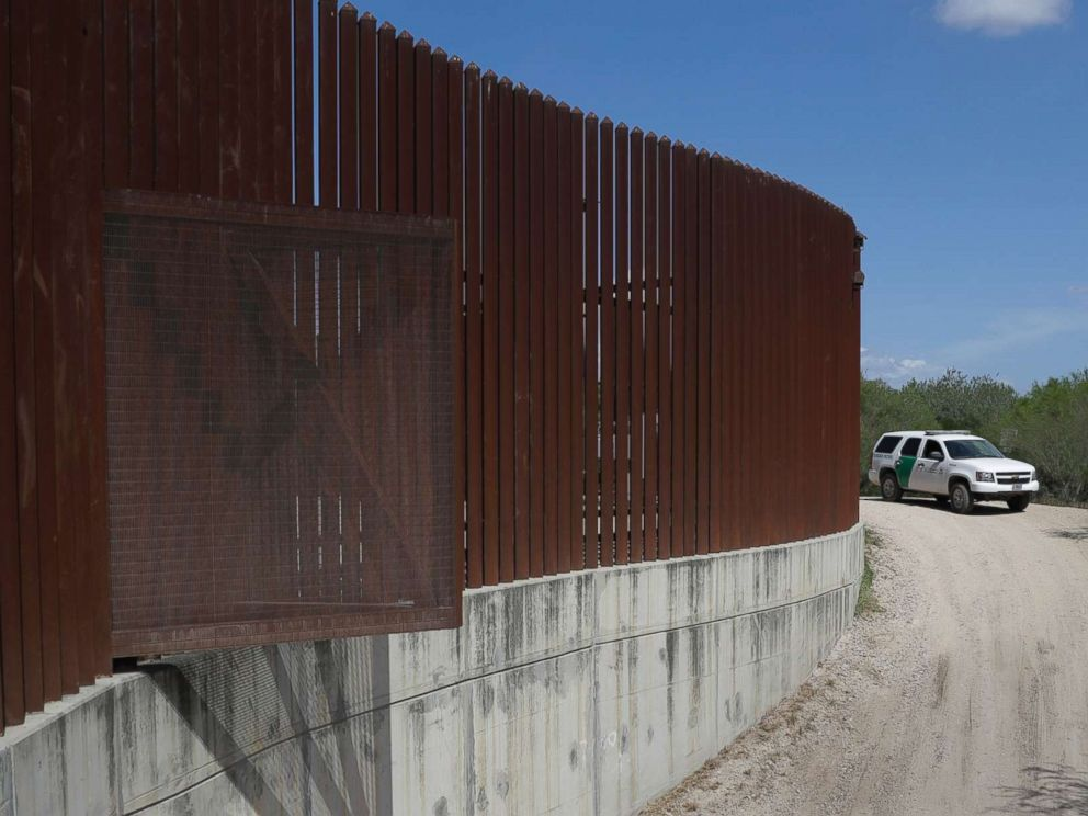 PHOTO: A U.S. Customs and Border Patrol vehicle passes along a section of border levee wall in Hidalgo, Texas, Aug. 11, 2017.