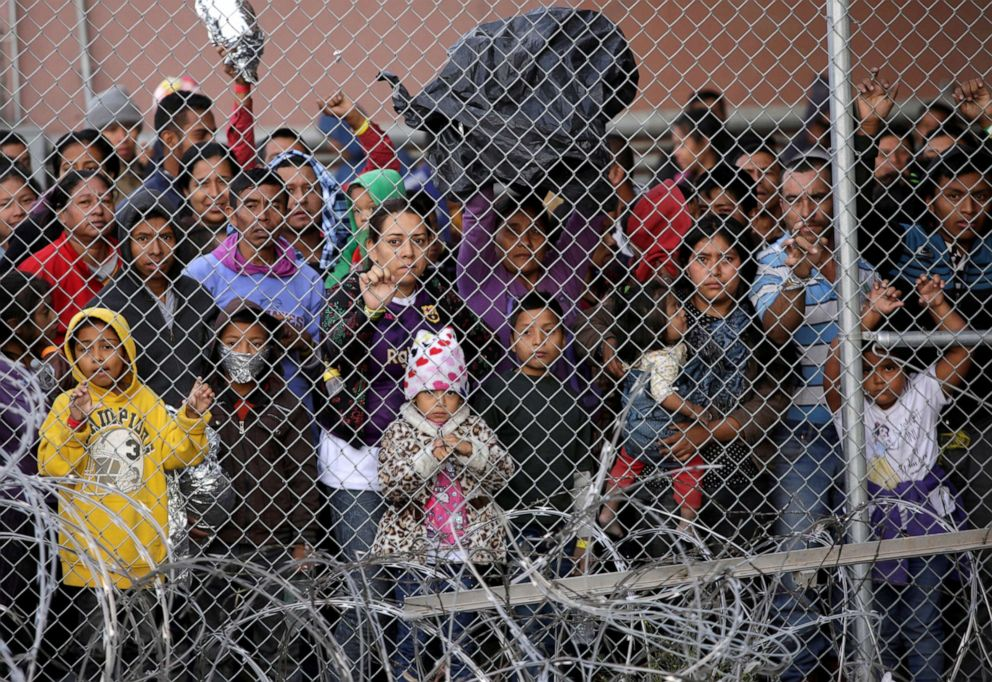 PHOTO: Central American migrants are seen inside an enclosure where they are being held by U.S. Customs and Border Protection (CBP), after crossing the border between Mexico and the United States, in El Paso, Texas, March 27, 2019.