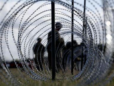 Militia leader arrested after holding migrants at gunpoint