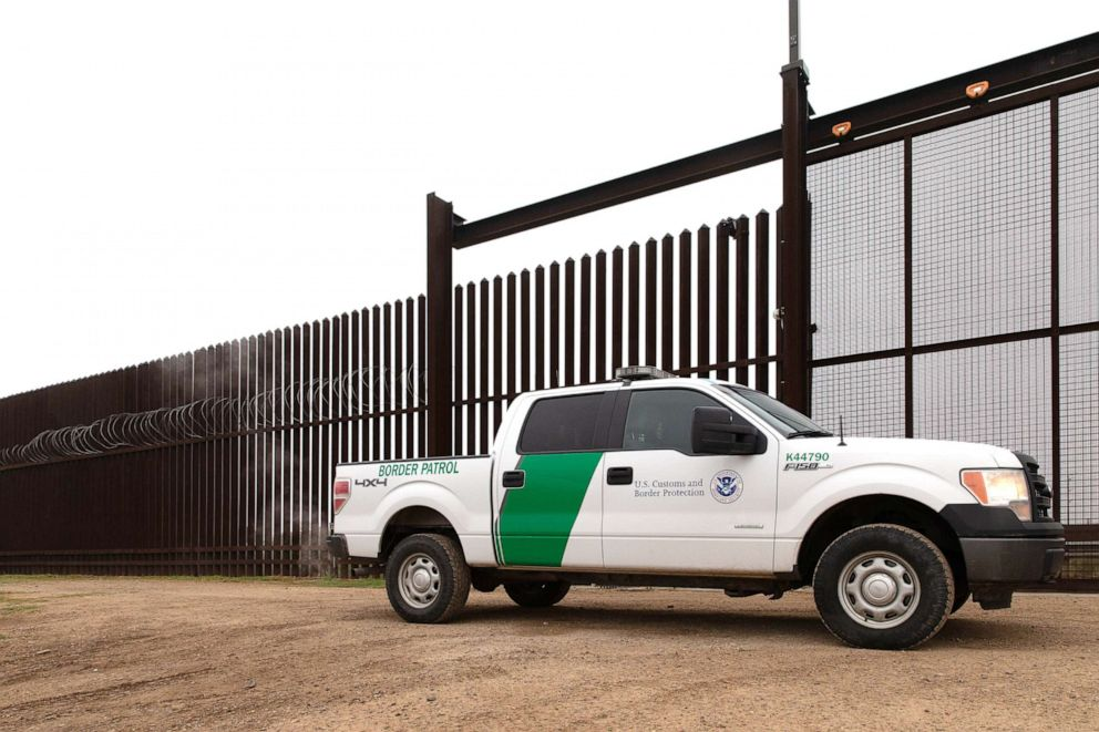 PHOTO: A U.S. Customs and Border Protection vehicle drives at the gate of the border fence at the U.S.-Mexican border on Jan. 15, 2019, in McAllen, Texas.