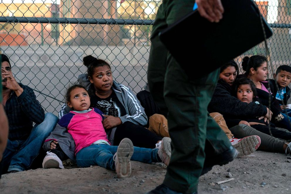 PHOTO: Migrants, mostly from Central America, wait to board a van which will take them to a processing center, May 16, 2019, in El Paso, Texas.