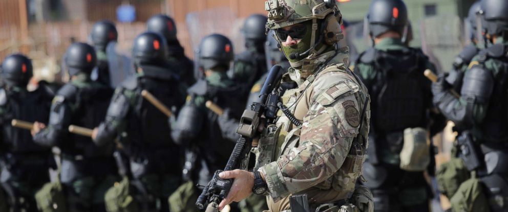 PHOTO: A Border Patrol agent and fellow U.S. Customs and Border Protection personnel take part in a training exercise at the U.S.-Mexico border, Nov. 5, 2018, in Hidalgo, Texas.