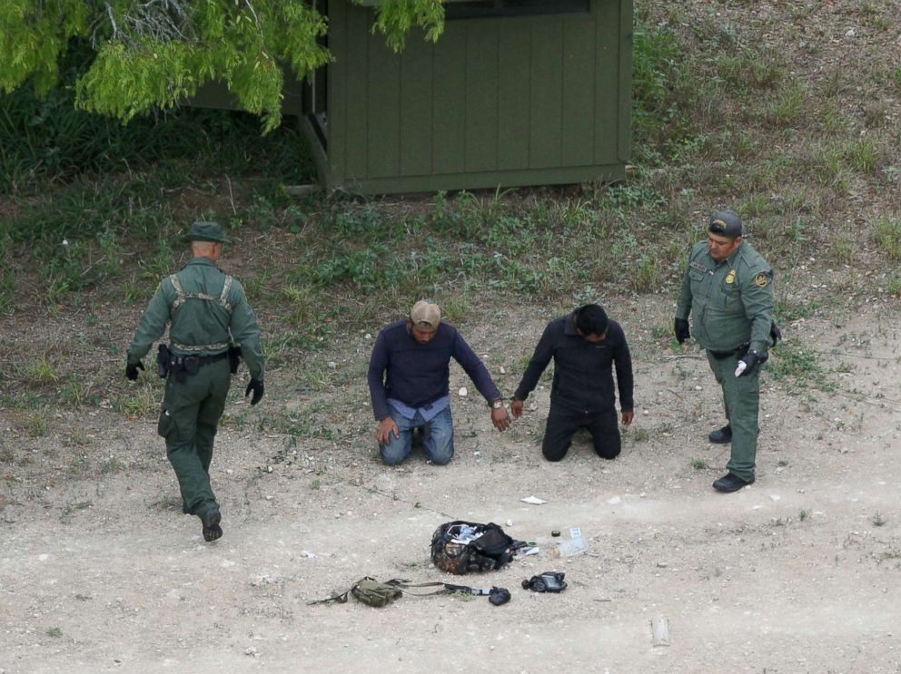 PHOTO: Border patrol agents apprehend people who illegally crossed the border from Mexico into the U.S. in the Rio Grande Valley sector, near Falfurrias, Texas, April 4, 2018.