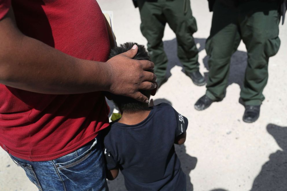 PHOTO: U.S. Border Patrol agents take a father and son from Honduras into custody near the U.S.-Mexico border, June 12, 2018, near Mission, Texas.