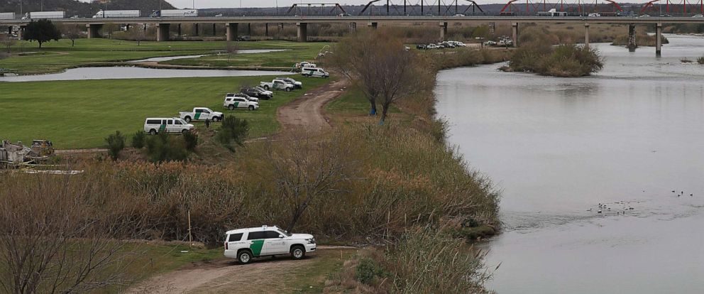 PHOTO: Law Enforcement and Border Patrol vehicles are seen as they line the banks of the Rio Grande at the U.S.-Mexico border on Feb. 08, 2019, in Piedras Negras, Texas.