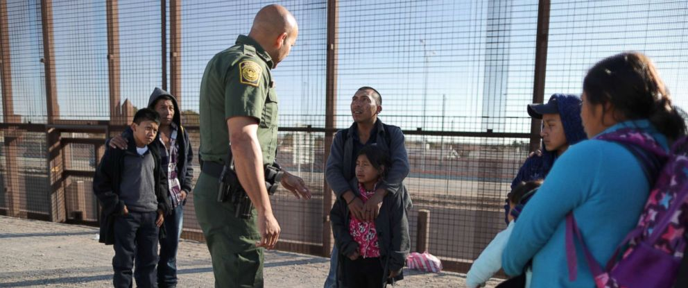 PHOTO: A group of Central American migrants is questioned about their childrens health after surrendering to U.S. Border Patrol Agents south of the U.S.-Mexico border fence in El Paso, Texas, March 6, 2019.
