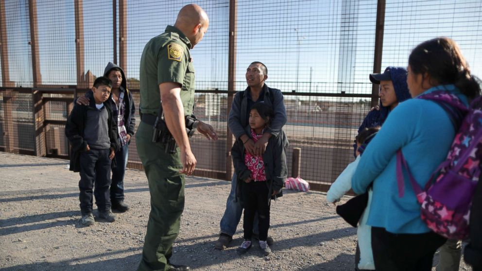 A group of Central American migrants is questioned about their children's health after surrendering to U.S. Border Patrol Agents south of the U.S.-Mexico border fence in El Paso, Texas, March 6, 2019.