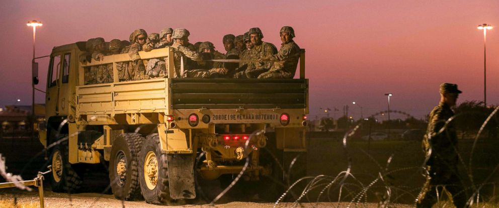 PHOTO: US Army troops enter a compound where the military is erecting an encampment near the US-Mexico border crossing at Donna, Texas.