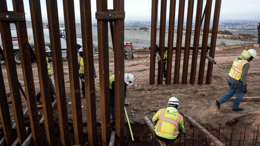 A construction crew works on replacing the U.S.-Mexico border fence near Tijuana, Mexico, Jan. 9, 2019.