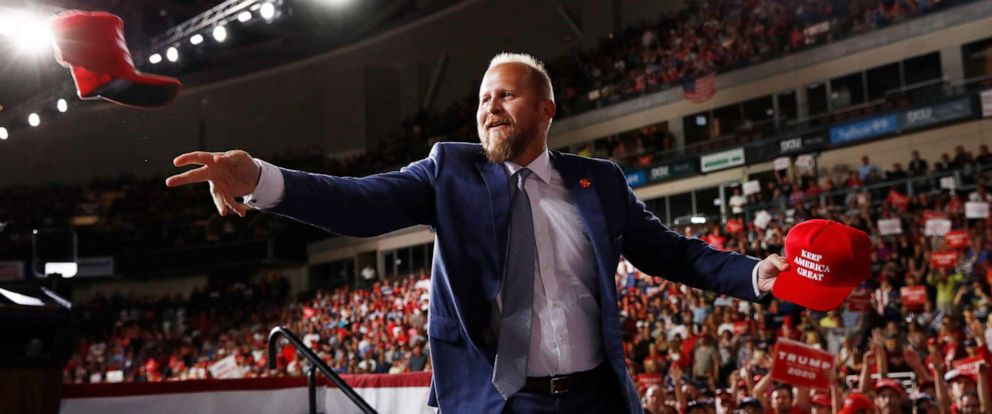 PHOTO: President Donald Trumps Campaign Manager Brad Parscale, tosses out hats to supporters before President Donald Trump speaks at a campaign rally, Thursday, Aug. 15, 2019, in Manchester, N.H.