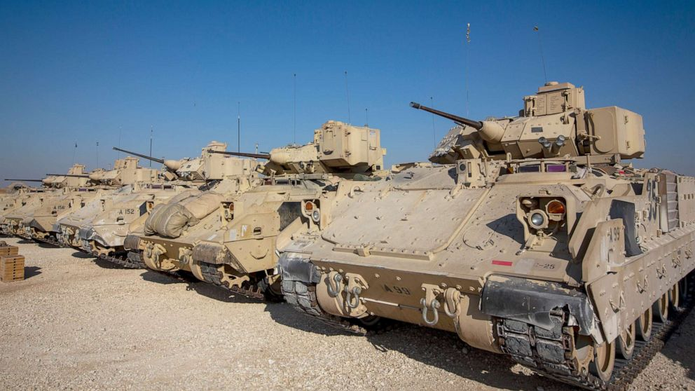 PHOTO: Bradley fighting vehicles are parked at a US military base at an undisclosed location in Northeastern Syria, Nov. 11, 2019.