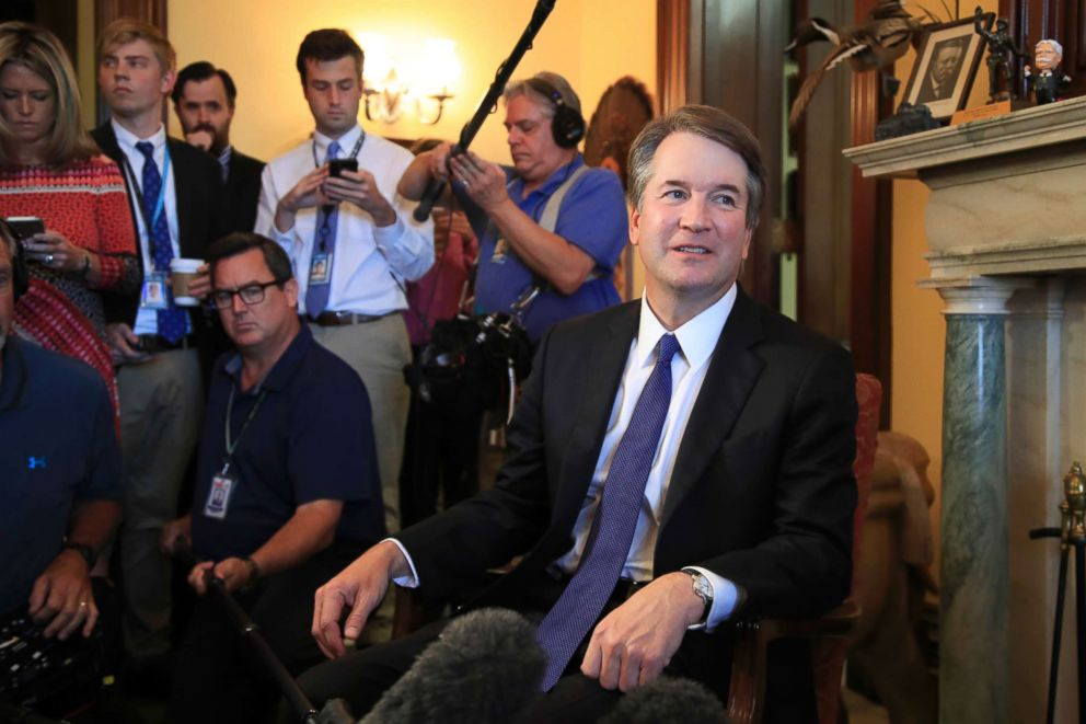 Supreme Court nominee Brett Kavanaugh listens to Sen. Rob Portman on Capitol Hill in Washington, during a meeting, July 11, 2018.