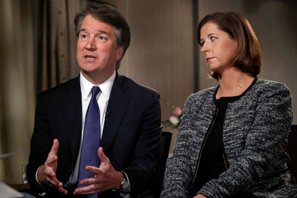 PHOTO: Brett Kavanaugh, sitting with his wife Ashley Estes Kavanaugh, answers questions during a FOX News interview on Sept. 24, 2018, in Washington.