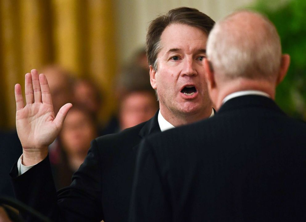 PHOTO: Brett Kavanaugh (L) is sworn-in as Associate Justice of the US Supreme Court by retired Associate Justice Anthony Kennedy at the White House, Oct. 8, 2018.