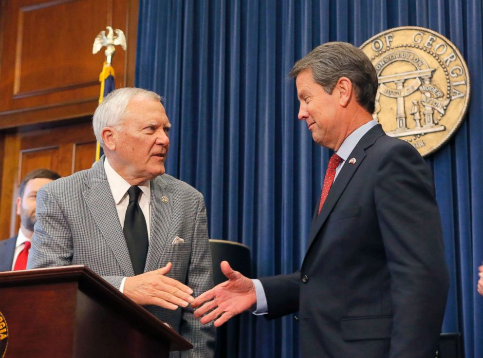 PHOTO: Republican Brian Kemp, right, shakes hands with Georgia Gov. Nathan Deal at the Capitol, Nov. 8, 2018, in Atlanta, Ga.