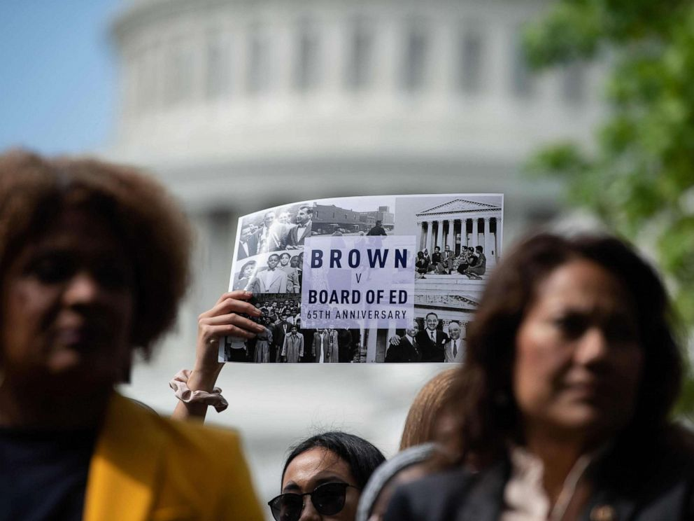 PHOTO: People attend a rally to mark the 65th anniversary of the US Supreme Courts Brown v Board of Education ruling that ended segregation in public schools, near the Capitol in Washington, DC, May 16, 2019.