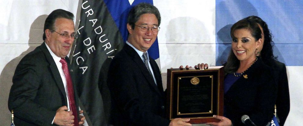 PHOTO: Marisela Morales, right, receives a recognition from Bruce Ohr, center, alongside US ambassador to Mexico, Anthony Wayne, Aug. 10, 2012, in Mexico.