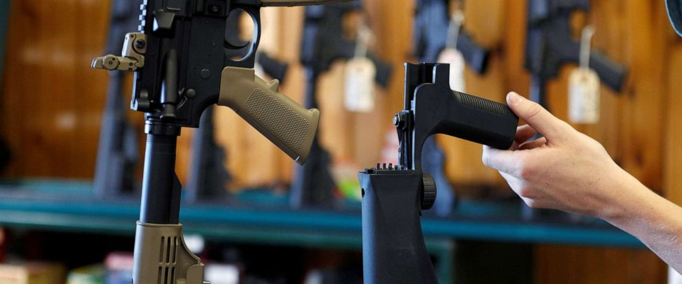 PHOTO: A bump fire stock, right, that attaches to a semi-automatic rifle to increase the firing rate is seen at Good Guys Gun Shop in Orem, Utah, Oct. 4, 2017.