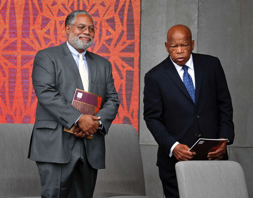PHOTO: Lonnie Bunch, left, director of the Smithsonian Museum of African American History and Culture, left, and Rep. John Lewis, D-Ga. take their seats for the dedication ceremony of the Smithsonian Museum of African American History and Culture.