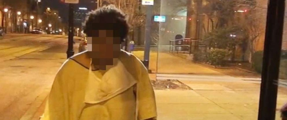 PHOTO: An image taken from video provided by Imamu Baraka shows a woman discharged from a Baltimore hospital at a bus stop wearing only a gown and socks on a cold winters nigh, Jan. 9, 2018.